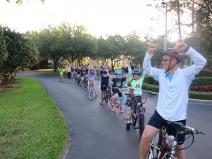 Principal Dave McMeen leads Hunter's Green Elementary students in a bicycle train parade during Bike to School Day 2013 in Tampa, Florida.